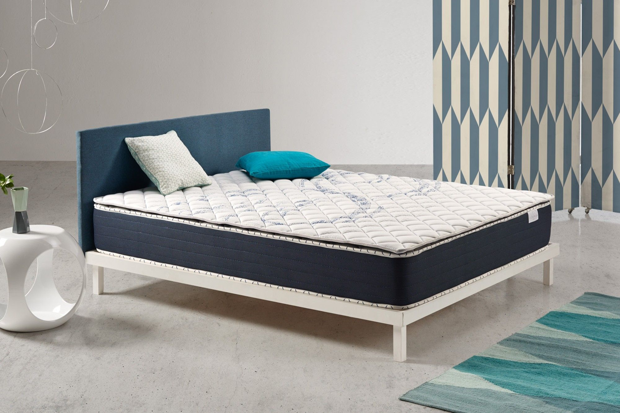 The Atlas high comfort mattress topper has high density memory foam on both the summer and winter sides.